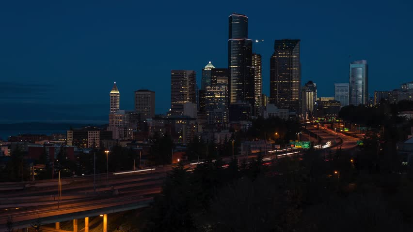 Time lapse video of the Seattle skyline and heavy flowing traffic during sunrise. 4k time lapse, 4096x2304.
