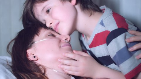 4k Hospital Shot of Sick Woman and Child Visiting and Kissing the Patient