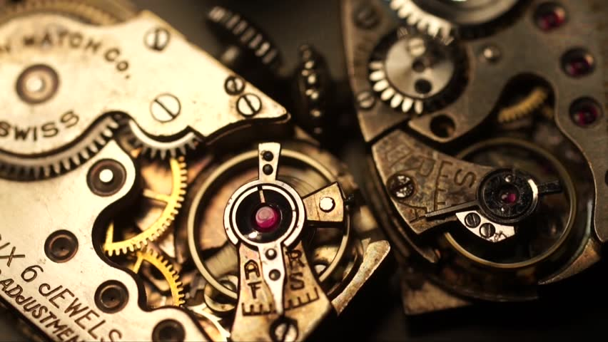 A pair of mechanical watch movements ticking.