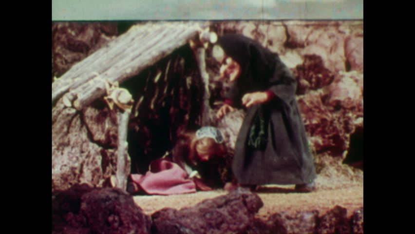 ANIMATED 1950s: Rapunzel cries as she lies on floor of mountain hut.
