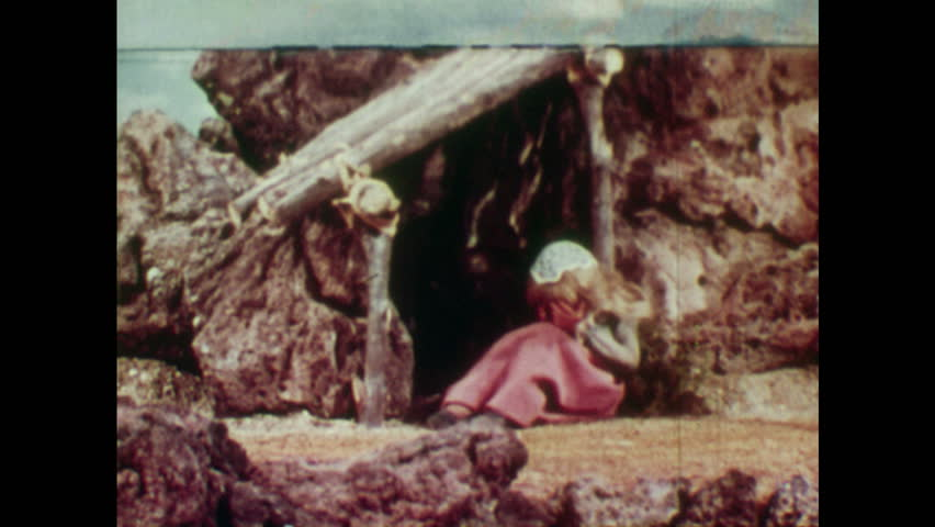 ANIMATED 1950s: Rapunzel sees young man and comforts him. Young man collapses in Rapunzel's arms and she begins to cry. Rapunzel's tears land on blind man's eyes.