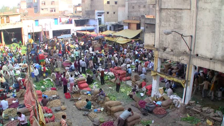 Crowded market with vendors selling vegetables on a local market on November 13, 2011 in Delhi, India.
