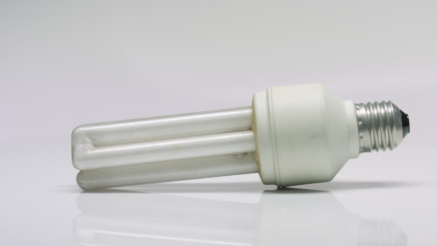 Rotating used compact triple tube fluorescent lamp with on white background | Shutterstock HD Video #21125590