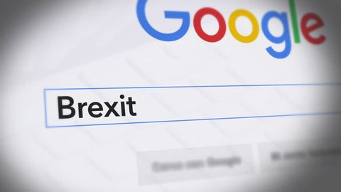 USA-Popular searches in 2015 Google Search Engine - Search For Brexit Monitor with reflection hands typing a search on google