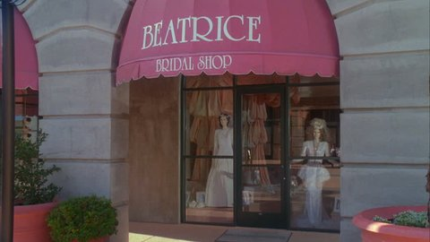 day Tight entrance Raked right Beatrice Bridal Shop wedding gowns mannequins display window