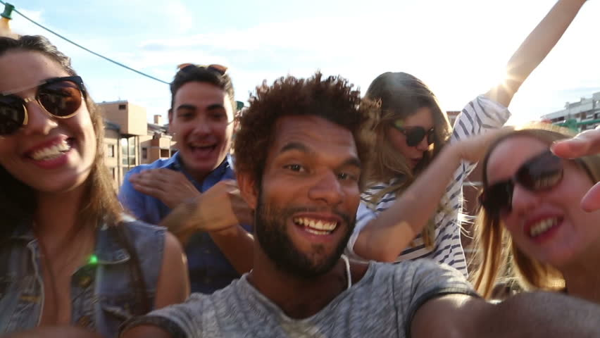 Close up of happy crazy multi-ethnic group of friends filming themselves at rooftop party on sunny day | Shutterstock HD Video #21176410