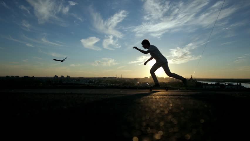skateboarder legs skateboarding at sunrise city skater