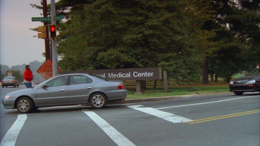 day Pan National Naval Medical Center sign corner wide LS white large stone hospital Bethesda Naval Hospital now known Walter Reed National Military Medical Center
