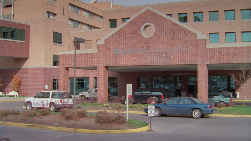 day Entrance Raked right Rose Medical Center, large modern brick hospital font color red b Name NEEDS be removed post