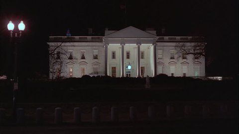 night across front north side White House barricades cars pre 9 11 bare trees, winter fall Washington DC landmark