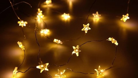 Christmas light, star shaped on dark background. Switch on and off