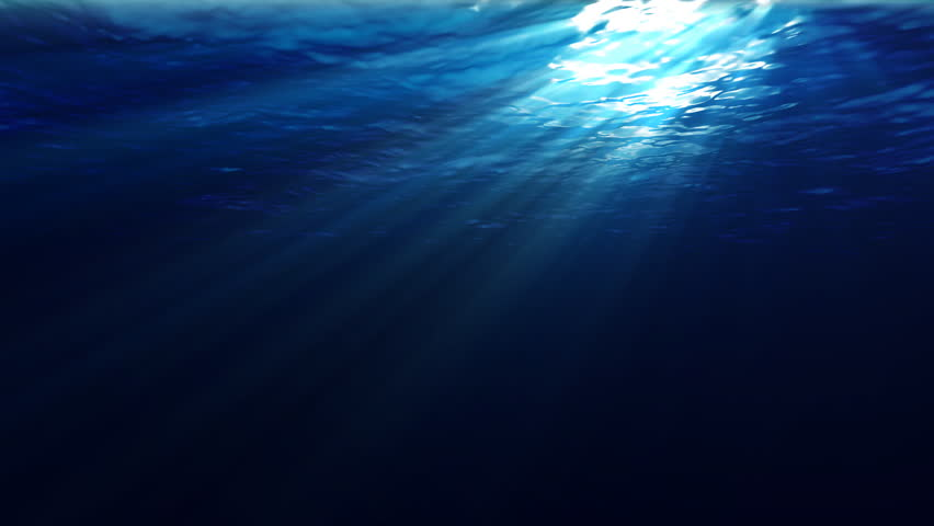 An underwater scene with sunrays shining through the water's glittering and moving surface. (Looping, Hight Definition 1080p)
