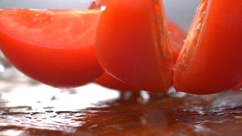 Slo-mo tomato falls into wedges