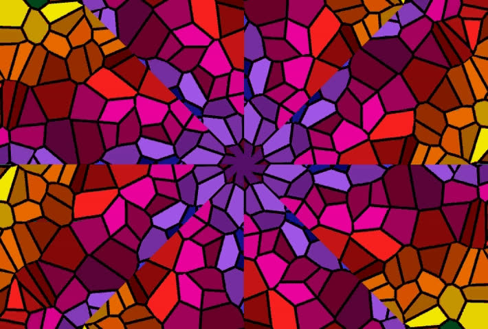 Abstract stained glass pinwheel in bright colors.