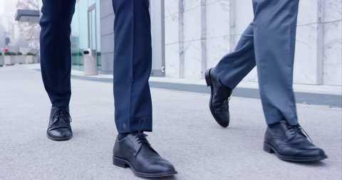 Slow-Mo Focused On Feet Of Two Business Men Walking On The Path Together