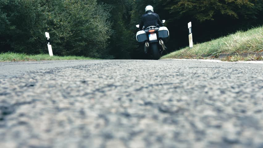 Riding motorcycle on backroads in rural landscape in Germany