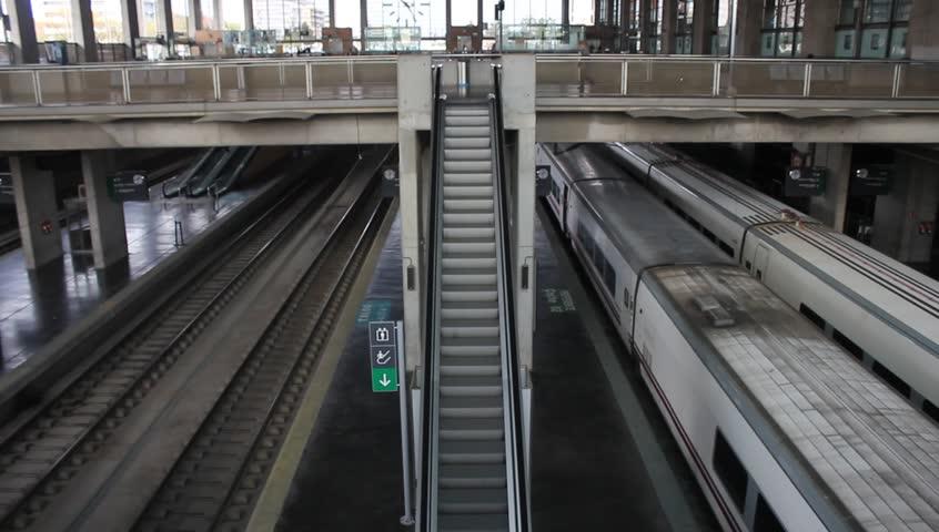 Businessman climbing up the escalator in a train station | Shutterstock HD Video #2131430