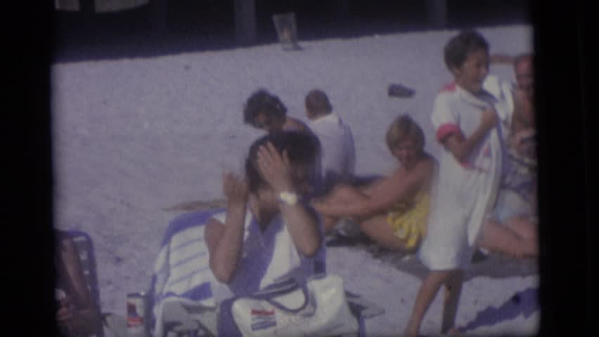 CAMDEN, NEW JERSEY 1965: family on a beach