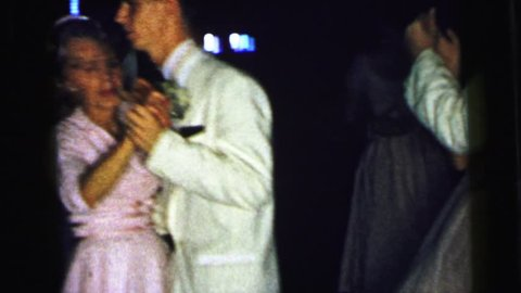 CAMDEN, NEW JERSEY 1964: older woman and younger man on a formal dance floor