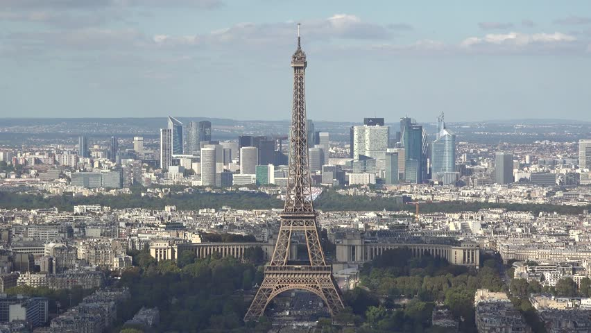 Eiffel tower in the heart of Paris city, modern La Defense buildings in background | Shutterstock HD Video #21397600