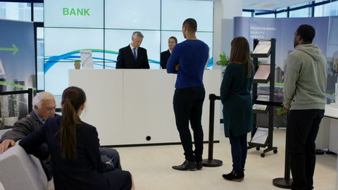 4K Bank customer having come in to a lot of money withdraws cash & throws notes in the air. Shot on RED Epic.