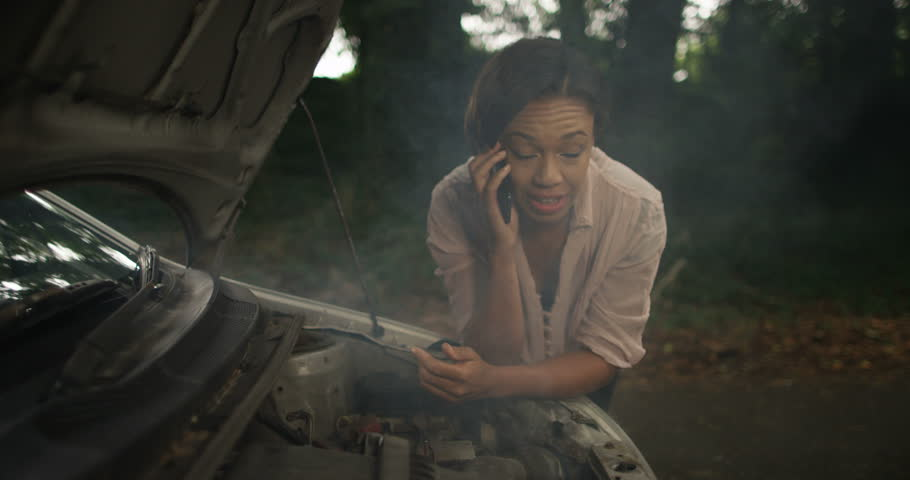 4k, A woman phoning roadside assistance because her car has broken down. Slow motion.