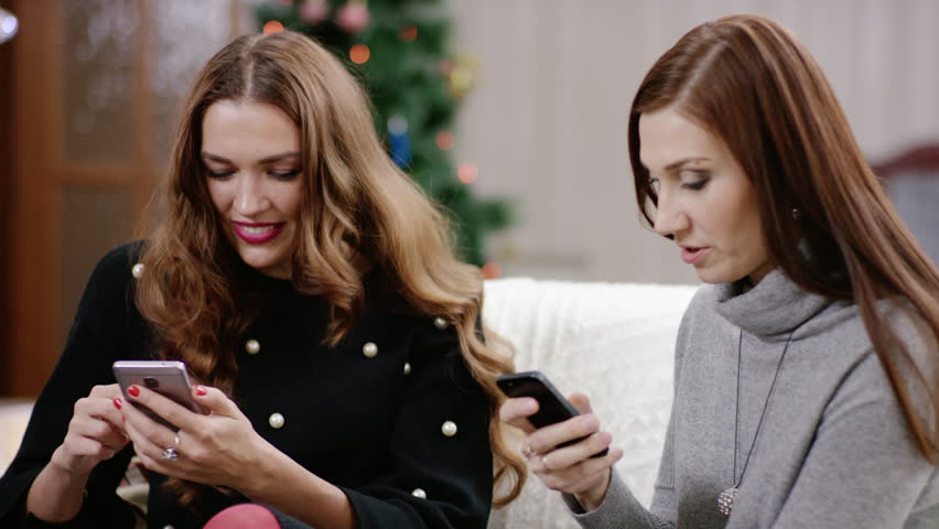 Women discussing and holding smartphone   Shutterstock HD Video #21426070