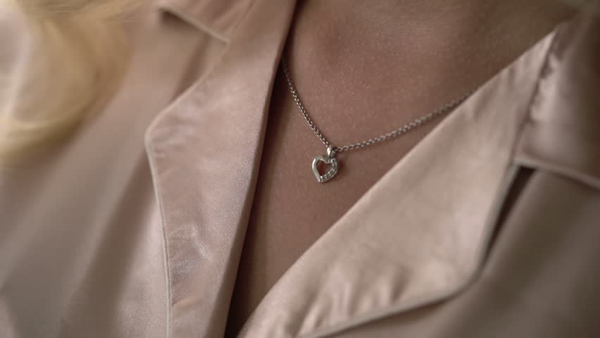 Woman touching pendant on her neck