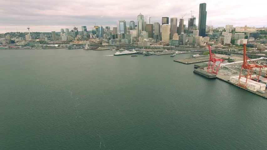 4K aerial view from ocean toward downtown Seattle buildings cloudy #21481630