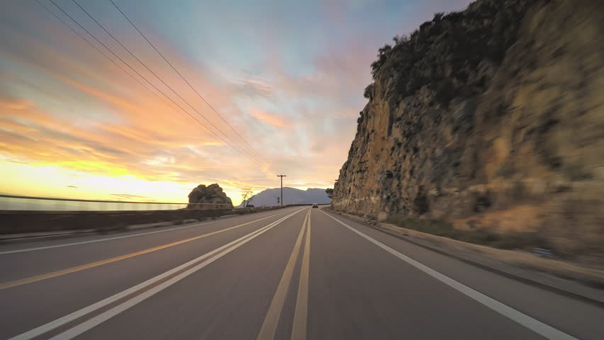 POV vehicle driving mediterranean coast countryside car travel road beautiful colorful sky romantic sunset skyline rocky coastline point of view Greece    Shutterstock HD Video #21500440