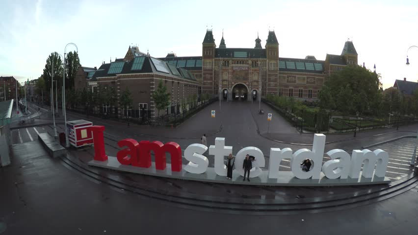 Short aerial at sunrise showing Rijksmuseum drone slowly moving towards Dutch national museum dedicated to arts and history Amsterdam very popular tourist attraction in Holland The Netherlands 4k