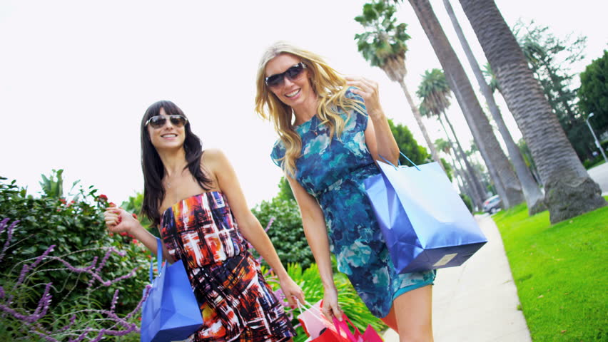 Young girlfriends on a shopping trip | Shutterstock HD Video #2153180