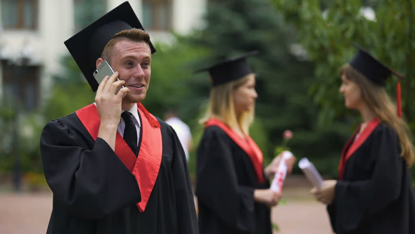 Happy male graduate receiving prestigious job offer, telephone conservation | Shutterstock HD Video #21534490