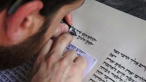 AUCKLAND - NOV 20 2016:Sofer writes a sefer Torah in Hebrew. In the Torah's 613 commandments, the second to last is that every Jew should write a Sefer Torah in their lifetime.