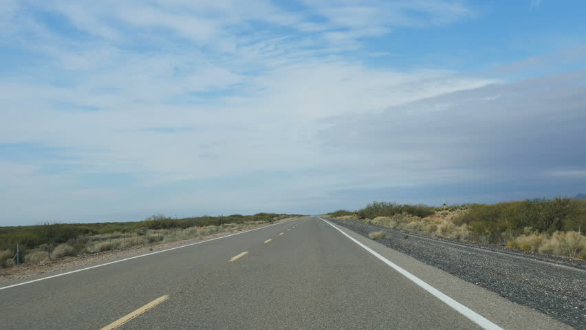POV-Road trip through the desert of New Mexico on State Road 9 paralleling the Mexico border between El Paso, Texas and Columbus, New Mexico.