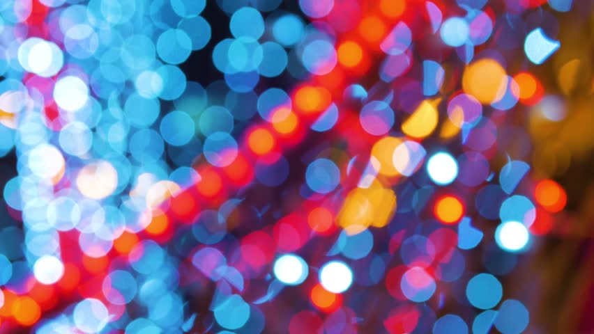 garland burn and flicker shimmer in soft focus bokeh Christmas or New Year background.