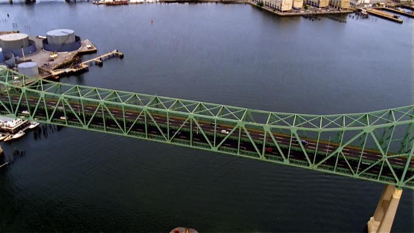 Aerial view long green bridge over river | Shutterstock HD Video #2157860