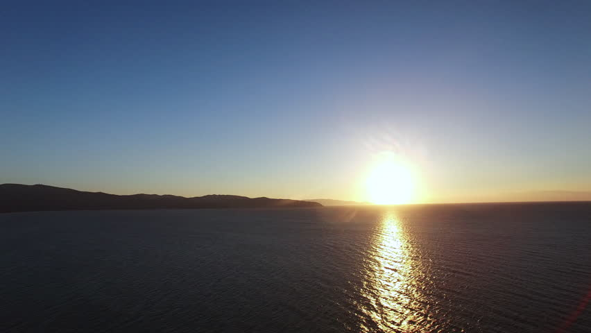Aerial sunset, Aerial drone video over the sea at the sunset in Italy near Monte Argentario. | Shutterstock HD Video #21595330