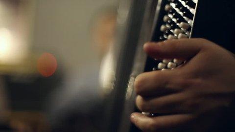 SAMARA, SAMARA REGION/RUSSIA - NOVEMBER 19: Musician plays the accordion in the club, fur accordion expand and shrink on November 19, 2016 in Samara