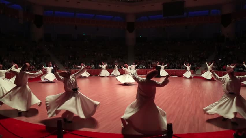 TURKEY-KONYA - JUNE 29, 2016: Sufi whirling dervish (Semazen) dances at konya during holy month of Ramadan.Semazen conveys God's spiritual gift to those are witnessing ritual.He spins with the music.