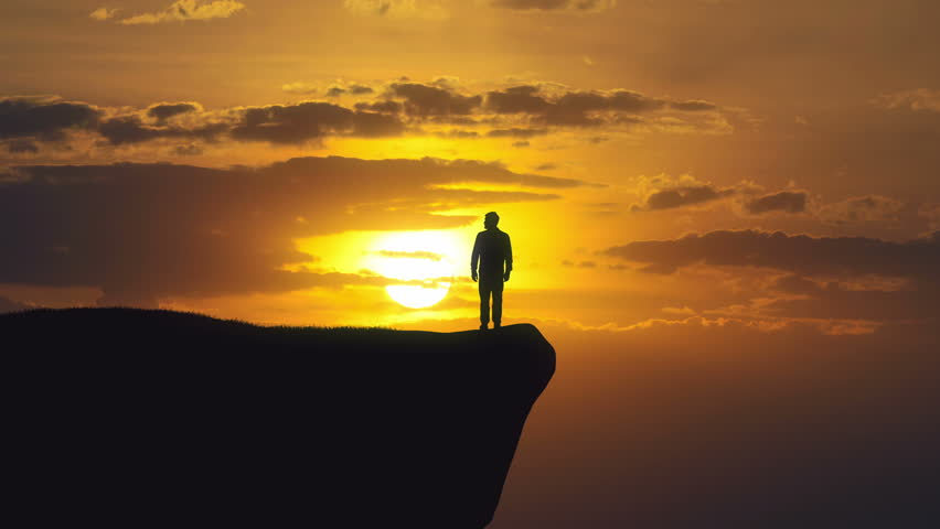 The man stand on a cliff of the mountain against the background of sunset. Time lapse | Shutterstock HD Video #21642310