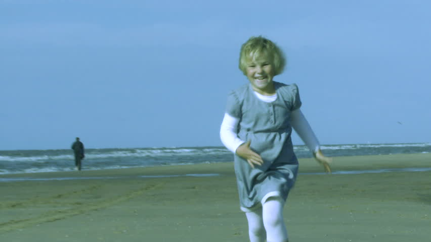 WIDE SHOT, Daughter running over beach into mothers arms