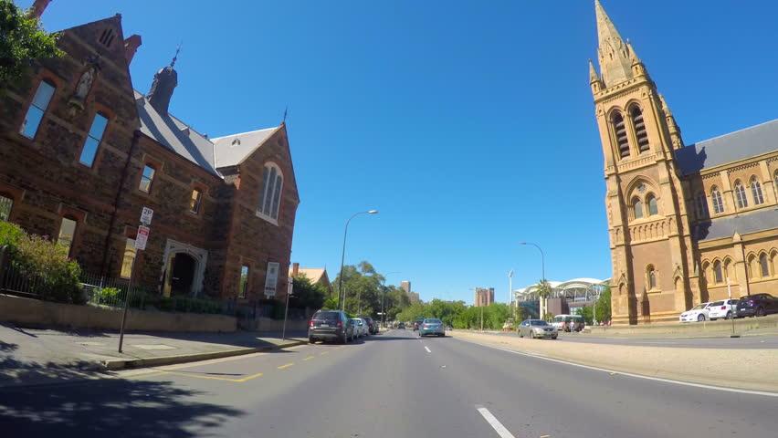 North Adelaide, South Australia vehicle POV, driving along King William Road, past the Adelaide Oval with views of the city.