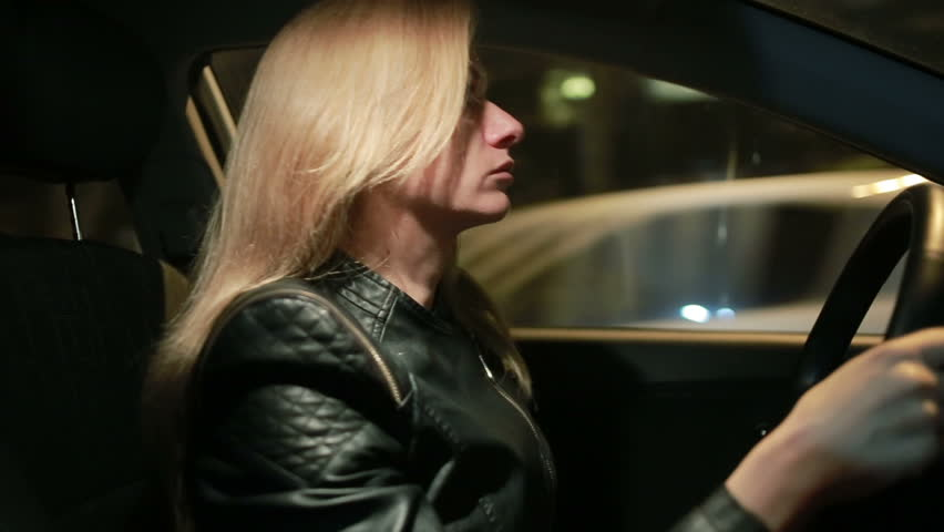Blondie young woman driving a car | Shutterstock HD Video #21694861