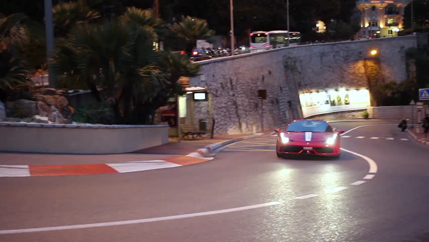 Monte-Carlo, Monaco - January 20, 2016: Luxury Red Ferrari 488 Driving Around the Fairmont Famous Hairpin Turn in Monte-Carlo, Monaco in The French Riviera