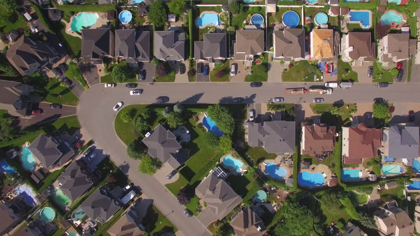 Aerial overhead view of residential neighborhood in the suburbs of Montreal on a summer day in Quebec, Canada.