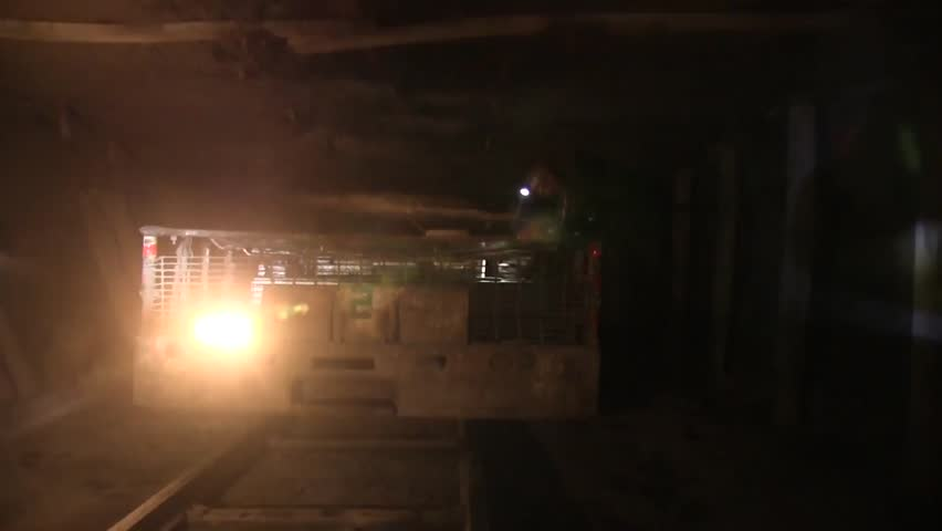 Whitesville, WV., Circa 2011: Coal Mine Grabs Gear from Mine Car in Underground Shaft   Shutterstock HD Video #21739870
