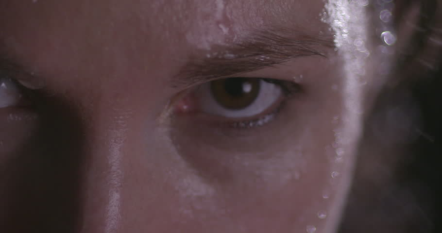 FEMALE BOXER WORKING OUT. Slow motion Extreme close up shot. A woman's left eye while she is breathing heavily #21741730