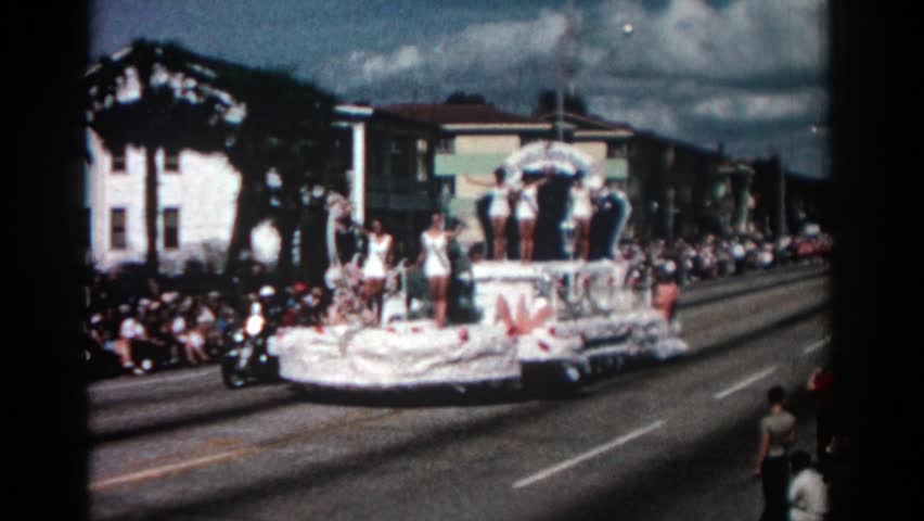 PASADENA CALIFORNIA 1962: a carriage with beautiful women who greet the public is parading through the streets