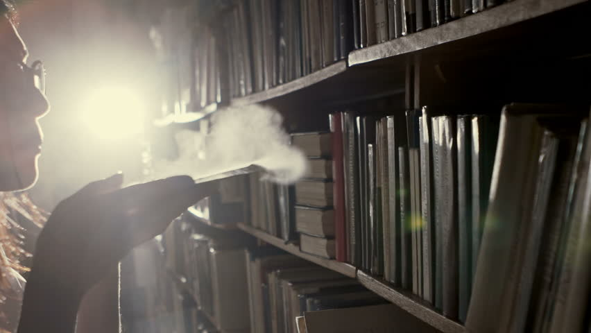 The girl in the library blown dust from the old quarter of the document